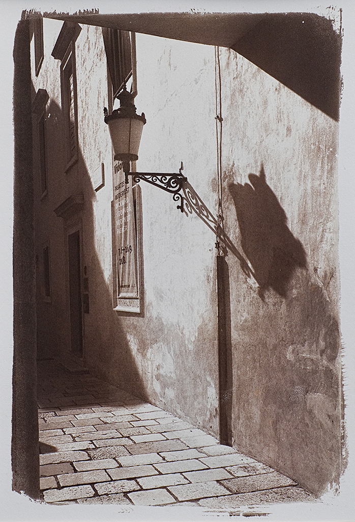"""Croatia Side Street"" © Alan Glover. Approx 11x7.5"" handcrafted Van Dyke Brown print from a single negative printed on Hahnemuhle Platinum Rag paper. GALLERY5X7 offers this original print, signed on the mount (mount size 16x12""), at $250."